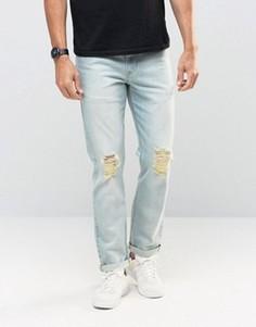 Синие узкие джинсы стретч с рваными коленками ASOS - Синий