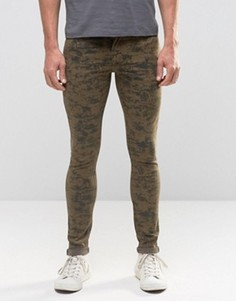 Супероблегающие джинсы с камуфляжным принтом ASOS - Зеленый