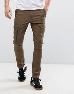 Супероблегающие брюки цвета хаки с карманами карго на молнии ASOS - Зеленый