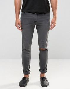 Супероблегающие джинсы с рваной отделкой и текстовым принтом ASOS - Черный