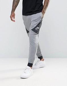 Серые спортивные штаны зауженного кроя Nike International 802375-091 - Серый