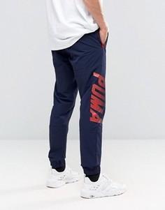 Спортивные тканые брюки в стиле колор блок Puma - Синий