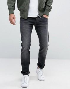 Выбеленные джинсы слим с заниженной талией Wrangler - Темно-синий