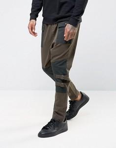 Спортивные штаны цвета хаки с заниженным шаговым швом ASOS - Зеленый