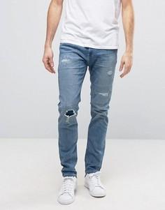 Синие джинсы скинни с рваной отделкой и декоративной штопкой Hollister - Синий
