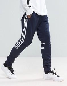 Темно-синие узкие джоггеры adidas Originals CLR84 BK5928 - Темно-синий