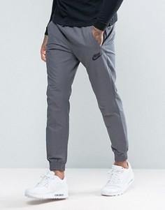 Серые джоггеры с вышитым логотипом Nike 804325-021 - Серый
