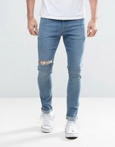 Синие выбеленные джинсы скинни с прорехами ASOS - Синий