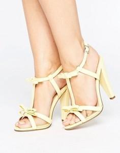 Желтые босоножки на каблуке с бантиком и ремешком через пятку Paper Dolls - Желтый