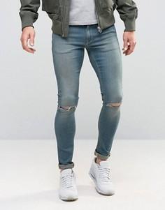 Супероблегающие джинсы с дырками на коленях ASOS - Синий
