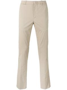 слегка расклешенные брюки-чинос Corneliani