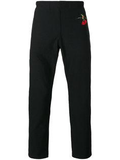 зауженные брюки с принтом ласточки Alexander McQueen