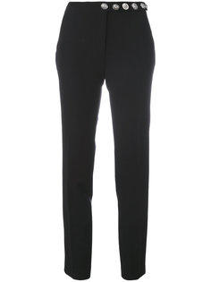 slim-fit trousers Versus