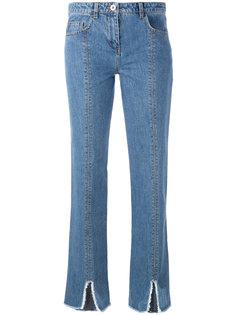 джинсы с вырезами на подоле Courrèges