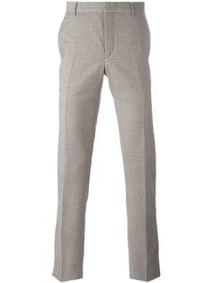 брюки-чинос с мелким узором Prada