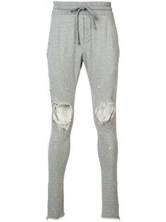 distressed track pants Amiri