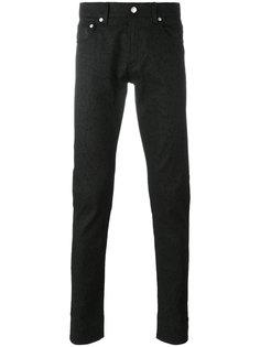 джинсы с леопардовым рисунком Alexander McQueen
