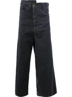 джинсы асимметричного кроя Maison Mihara Yasuhiro