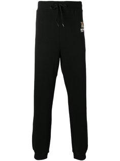 спортивные брюки с принтом плюшевого медведя Moschino