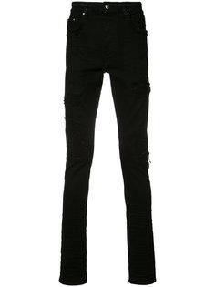джинсы с потертой отделкой Amiri