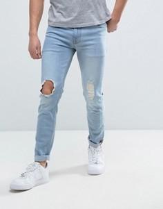 Выбеленные джинсы скинни с рваными коленями ASOS - Синий