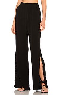 Расклешенные широкие брюки с разрезом - Raquel Allegra