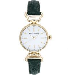 Часы округлой формы с кожаным ремешком Anne Klein