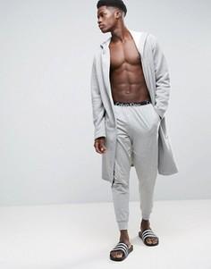 Джоггеры классического кроя с манжетами Calvin Klein - Серый