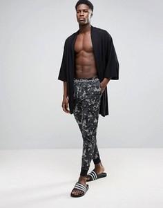 Джоггеры классического кроя с манжетами и камуфляжным принтом Calvin Klein - Зеленый