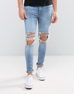 Умеренно выбеленные супероблегающие джинсы с прорехами New Look - Синий