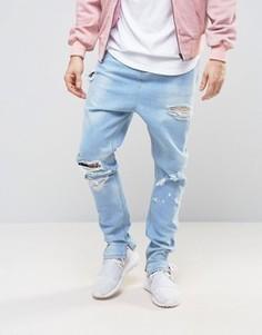 Выбеленные джинсы с рваной отделкой и заниженным шаговым швом ASOS - Синий