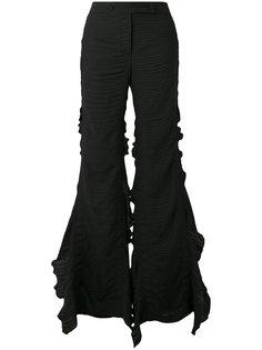 расклешенные брюки с оборками Marco De Vincenzo