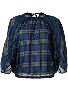 checked blouse En Route