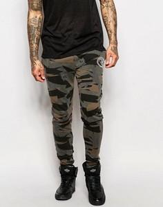 Зауженные спортивные брюки с камуфляжным принтом Criminal Damage - Зеленый