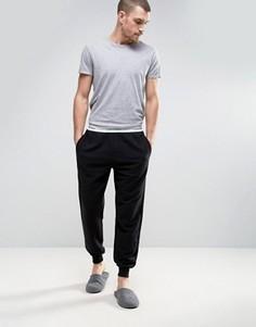 Джоггеры классического кроя с манжетами Calvin Klein - Черный