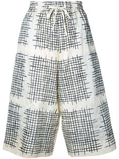 checked cropped trousers Toogood