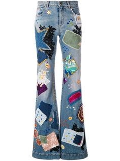 джинсы клеш в стиле пэчворк  Roberto Cavalli