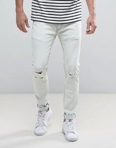 Зауженные эластичные джинсы с рваной отделкой Soul Star - Синий