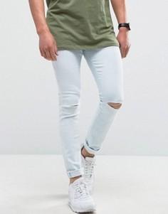 Светлые супероблегающие джинсы с рваными коленями Hoxton Denim - Синий