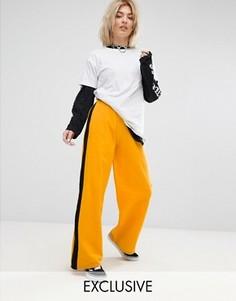 Широкие джоггеры с полосками по бокам Adolescent Clothing - Желтый