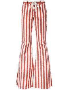 расклешенные полосатые джинсы Roberto Cavalli