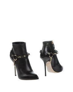 Полусапоги и высокие ботинки Daniele Michetti