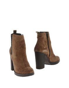 Полусапоги и высокие ботинки Carmens