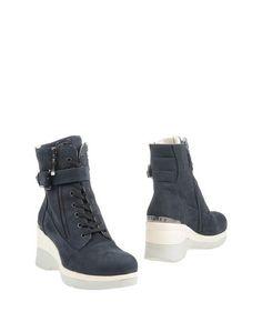 Полусапоги и высокие ботинки Cesare P.