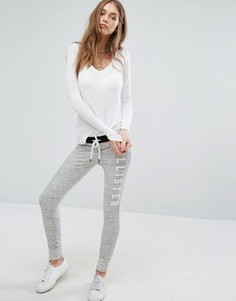 Спортивные брюки скинни с логотипом на поясе Hollister - Серый