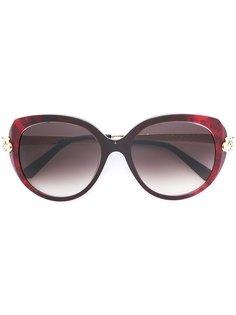 солнцезащитные очки в круглой оправе Cartier