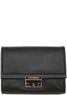 Кожаная поясная сумка Coccinelle