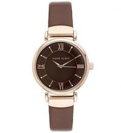 Часы круглой формы с кожаным браслетом Anne Klein