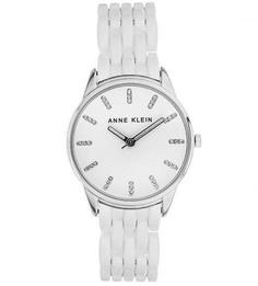 Часы с круглым циферблатом и широким пластиковым браслетом Anne Klein