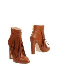Полусапоги и высокие ботинки Maiyet